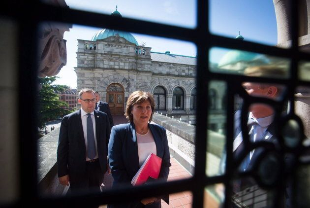 Now-former British Columbia Premier Christy Clark walks from her office to attend a confidence vote in Victoria, B.C., on June 29, 2017.
