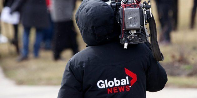 A Global News insignia on a cameraman's jacket, Montreal, Que., April 8,