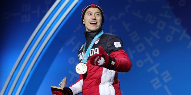 Patrick Chan of Team Canada celebrates during the medal ceremony after the Figure Skating Team Event...