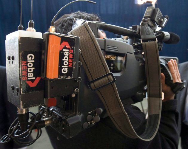 A Global News cameraman films at the Oliphant Commission in Ottawa, Tuesday April 14,