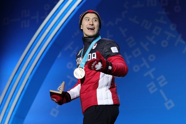 Patrick Chan celebrates during the medal ceremony after the Figure Skating Team Event in PyeongChang on Feb. 12.