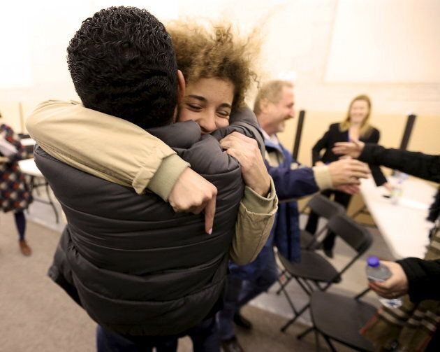 Anas Francis is reunited with his cousin Syrian refugee Laila Beylouneh, 13, at the Welcome Centre in Montreal, Que., on Dec. 12, 2015.