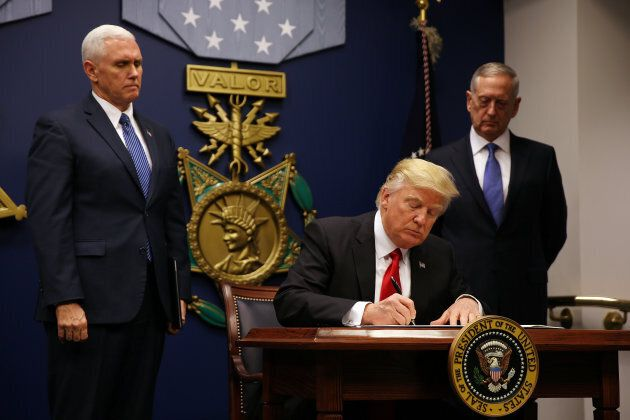 U.S. President Donald Trump signs a revised executive order for a U.S. travel ban, leaving Iraq off the list of targeted countries, at the Pentagon in Washington, U.S., on Jan. 27, 2017.