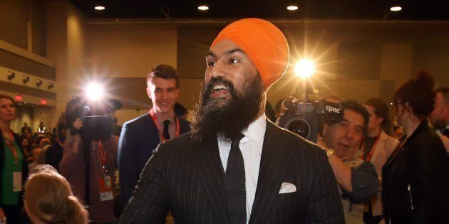 Jagmeet Singh shakes hands with delegates as he arrives at the NDP convention in Ottawa on