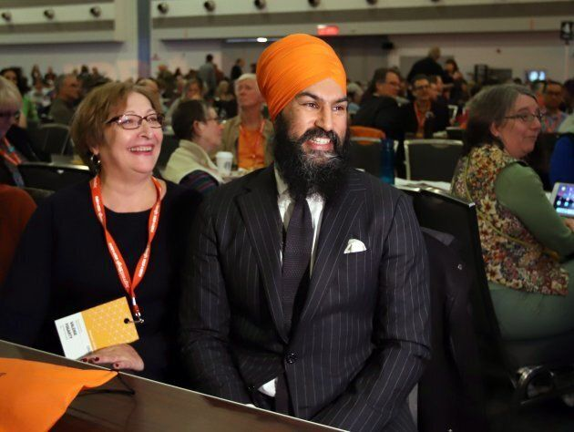 Jagmeet Singh sits with delegates at the NDP convention in Ottawa on