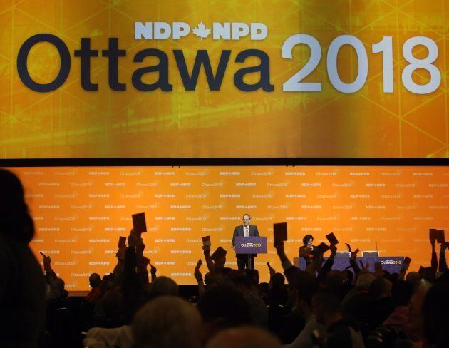 NDP delegates show hands as they vote on resolutions in Ottawa on