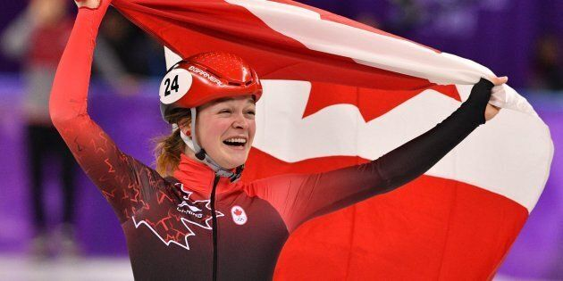 Canada's Kim Boutin celebrates her bronze in the women's 1,500-metre short-track speedskating