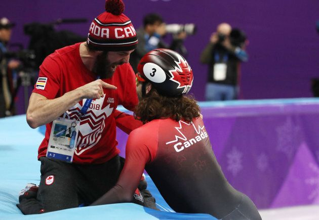 Charles Hamelin, left, celebrates with Samuel Girard after the Olympic rookie won the 1,000-metre event...