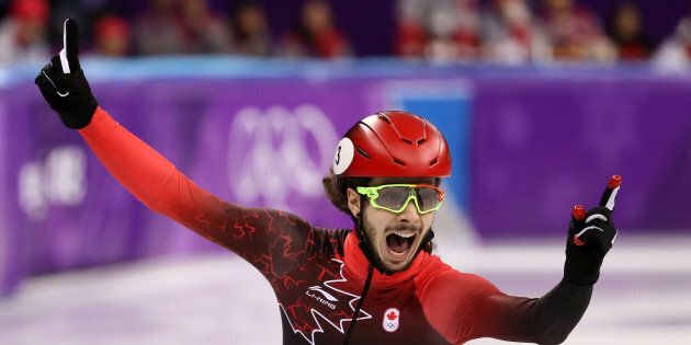 Canada's Samuel Girard has won gold in the 1,000-metre short-track speedskating