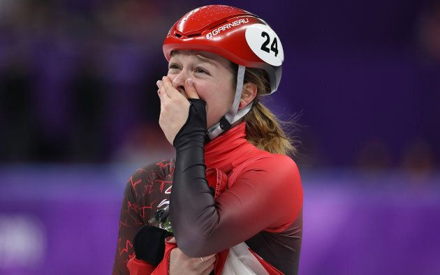 Kim Boutin of Canada celebrates after the 1,500-metre short track