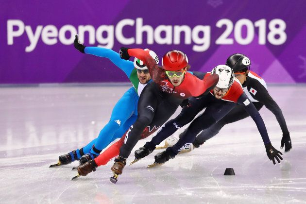 Canada's Samuel Girard, front, competes in the 1,000-metre-event in short-track