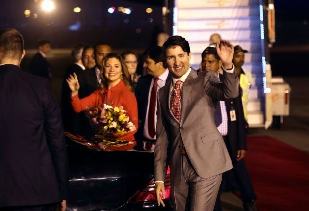 Canadian Prime Minister Justin Trudeau and his wife, Sophie Gregoire Trudeau, wave upon their arrival...