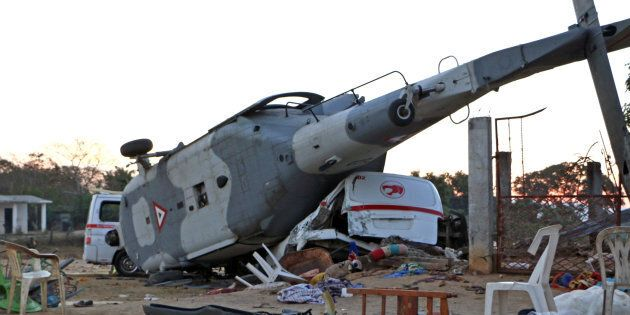 The remains of a military helicopter that fell on a van in Santiago Jamiltepec, Oaxaca state, Mexico,...