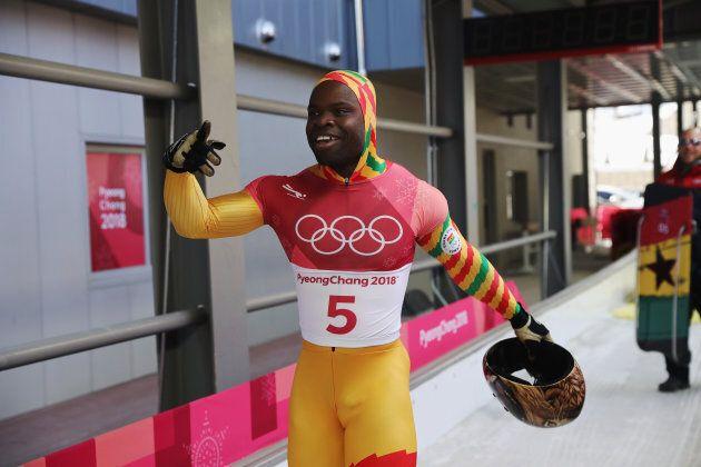 Akwasi Frimpong of Ghana celebrates his run in men's skeleton at