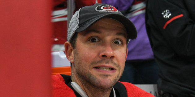 Goalie Cam Ward shows some emotion as he is honoured for reaching 300 wins during a game at the PNC Arena...