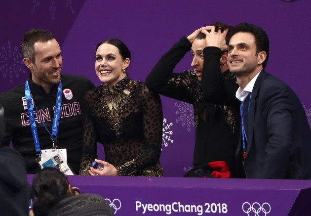 Tessa Virtue and Scott Moir find out their score after performing their short dance during at the 2018...