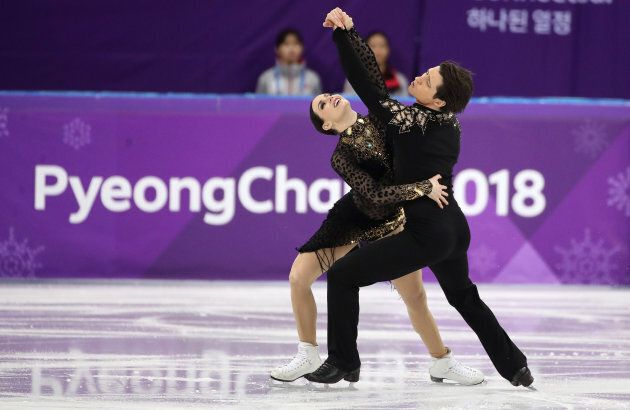Tessa Virtue and Scott Moir skate in the ice dance free