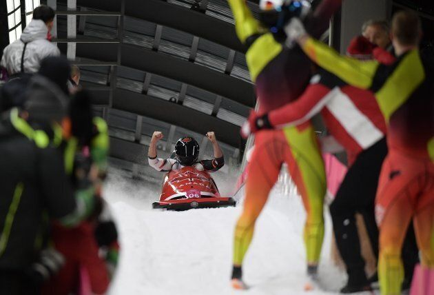 Canada's Alexander Kopacz and Justin Kripps celebrate at the finish line of the two-man