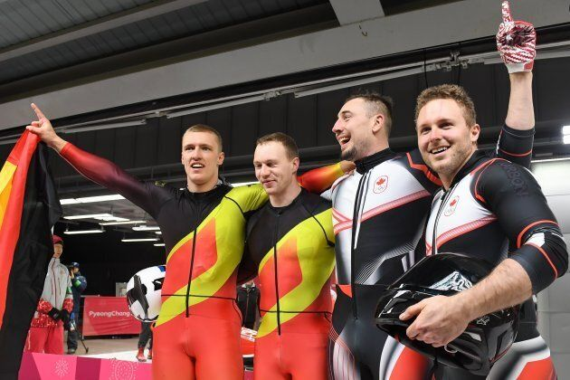 Germany's Francesco Friedrich, left, and Thorsten Margis, second left, celebrate with Canada's Alexander...