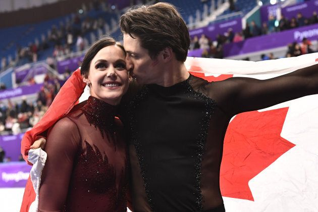 Canada's Tessa Virtue and Canada's Scott Moir celebrate after the ice dance event.