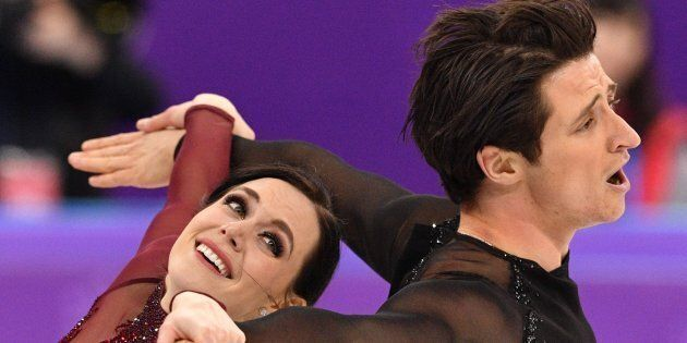Canada's Tessa Virtue and Scott Moir compete in the ice dance free skate Monday