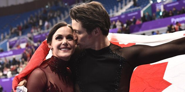 Tessa Virtue and Scott Moir celebrate after the ice dance free dance during the 2018