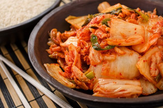A bowl of traditional Korean napa kimchi with white rice.