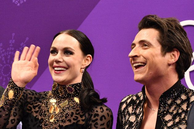 Virtue and Moir react after competing in the ice dance short dance figure skating event during the 2018...