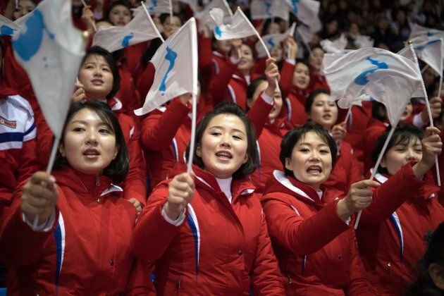 North Korean cheerleaders wave unified Korean flags as they perform during the PyeongChang