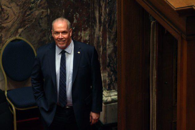 Premier John Horgan arrives at the legislative assembly before Finance Minister Carole James delivers...