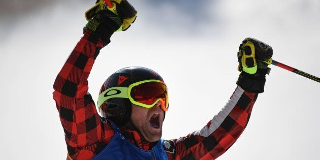 Canada's Brady Leman celebrates after winning the men's ski cross