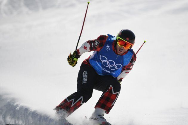 Canada's Brady Leman crosses the finish line first in the men's ski cross big