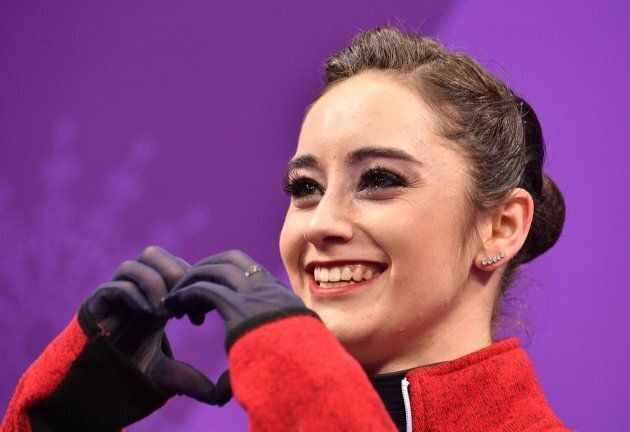 Canada's Kaetlyn Osmond reacts after her performance in the women's single skating short
