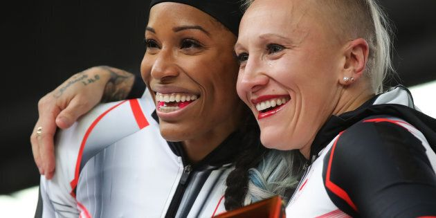 Kaillie Humphries and Phylicia George of Canada celebrate their bronze