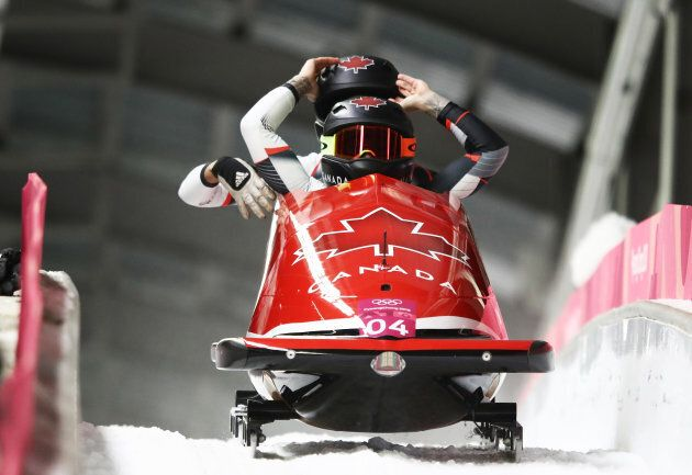 Kaillie Humphries and Phylicia George of Canada celebrate in the finish area during the women's bobsled