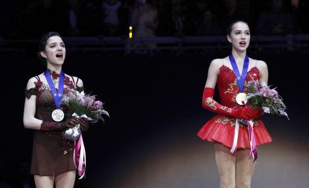 Gold medallist Alina Zagitova of Russia (R) and silver medallist Evgenia Medvedeva of Russia attend the...