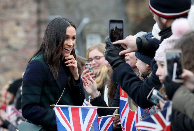 Meghan Markle meets members of the public during a walkabout at Edinburgh Castle.