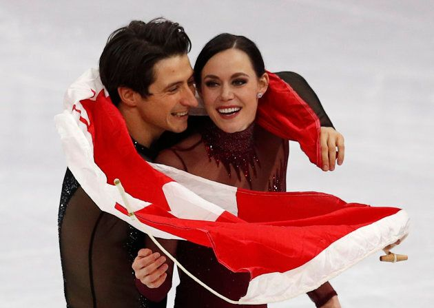 Gold medallists Tessa Virtue and Scott Moir leave the ice after the ice dance competition at the Pyeongchang 2018 Winter Olympics, Feb. 20, 2018.