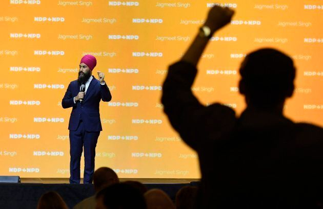 A delegate gives a standing ovation to NDP Leader Jagmeet Singh as he speaks during the policy convention...