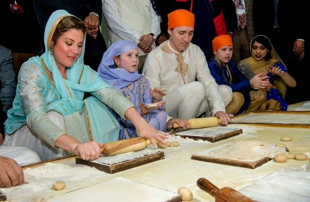 Prime Minister Justin Trudeau and his wife Sophie Gregoire Trudeau make Rotis or Indian flat bread during...