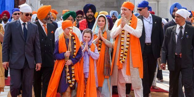 Prime Minister Justin Trudeau walks with his family members during their visit to Golden Temple, in Amritsar,...