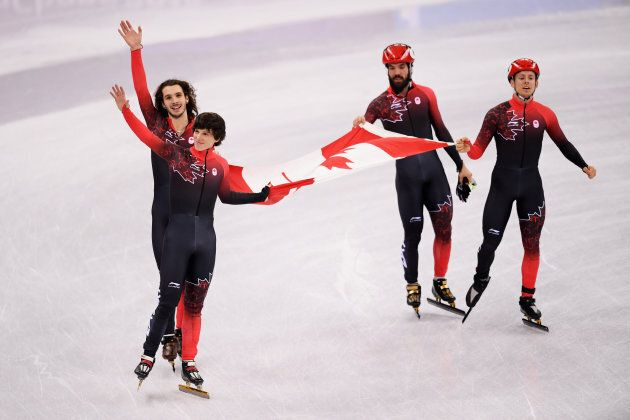 Samuel Girard, Charles Hamelin, Charlie Cournoyer and Pascal Dion of Canada celebrate winning the bronze...