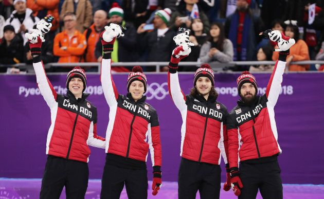 Bronze medalists Samuel Girard, Charles Hamelin, Charle Cournoyer and Pascal Dion of Canada celebrate...