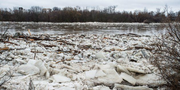 Ice is seen in the high waters of the Grand River in Brantford where residents were being evacuated due...