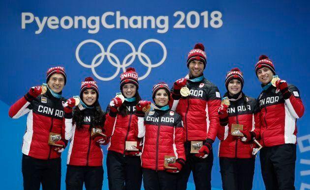 Patrick Chan, Gabrielle Daleman, Kaetlyn Osmond, Meagan Duhamel, Eric Radford, Tessa Virtue, and Scott Moir with their gold medals in the Team Skate on Feb, 12.