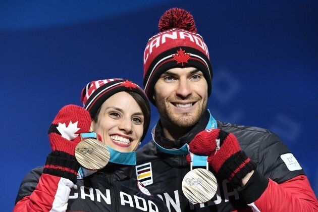 Meagan Duhamel and Eric Radford during the medal ceremony for the figure skating pair event at 2018 Olympics.