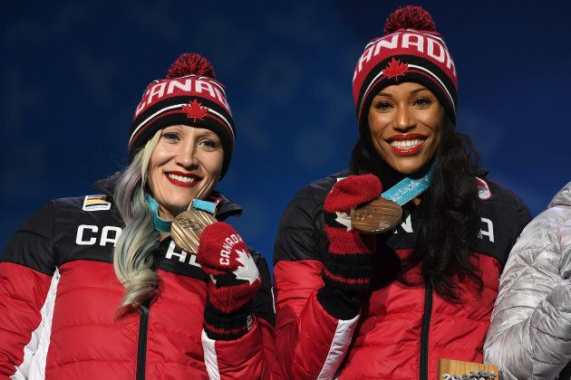 Bronze medalists Kaillie Humphries and Phylicia George of Canada celebrate during the medal ceremony for Bobsleigh - Women on day 13 of the PyeongChang 2018 Winter Olympic Games on Feb. 22, 2018
