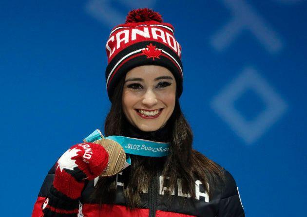Bronze medalist Kaetlyn Osmond of Canada on the podium.