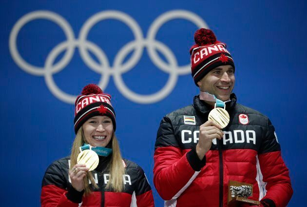 Kaitlyn Lawes and John Morris on the podium on Feb. 14, 2018 at the 2018 Winter Olympics.