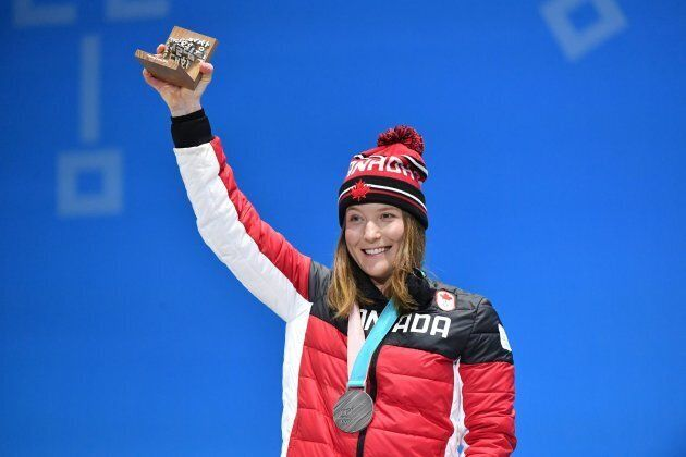 Canada's silver medalist Brittany Phelan poses on the podium during the medal ceremony for the freestyle skiing Women's skicross during the PyeongChang 2018 Winter Olympic Games on Feb. 23, 2018.